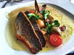 Sea bass fillet with mussel and vegetables