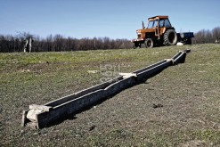 Wooden trough, farm tractor and hollow tree trunk