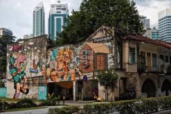 Graffiti and modern buildings in Kuala Lumpur