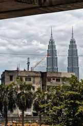 Kuala Lumpur Petronas twin-towers view from behind an old city quarter