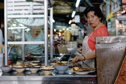 Woman in a cookshop at Saigon central market