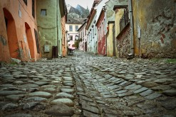 Sighisoara (Schässburg), Transylvania, cobblestone lane with mountain church view