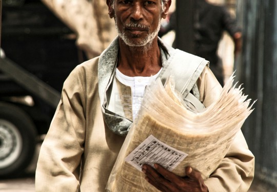 Papyrus vendor with emerald ring